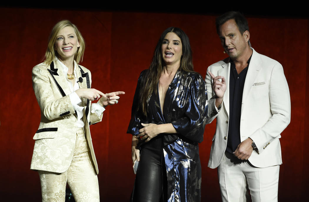 """Cate Blanchett, left, and Sandra Bullock, center, cast members in the upcoming film """"Ocean's 8,"""" mingle with host Will Arnett during the Warner Bros. Pictures presentation at CinemaCon 2 ..."""