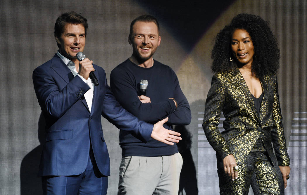 """Tom Cruise, left, star of the upcoming film """"Mission: Impossible - Fallout,"""" addresses the audience alongside fellow cast members Simon Pegg, center, and Angela Bassett during the Paramo ..."""