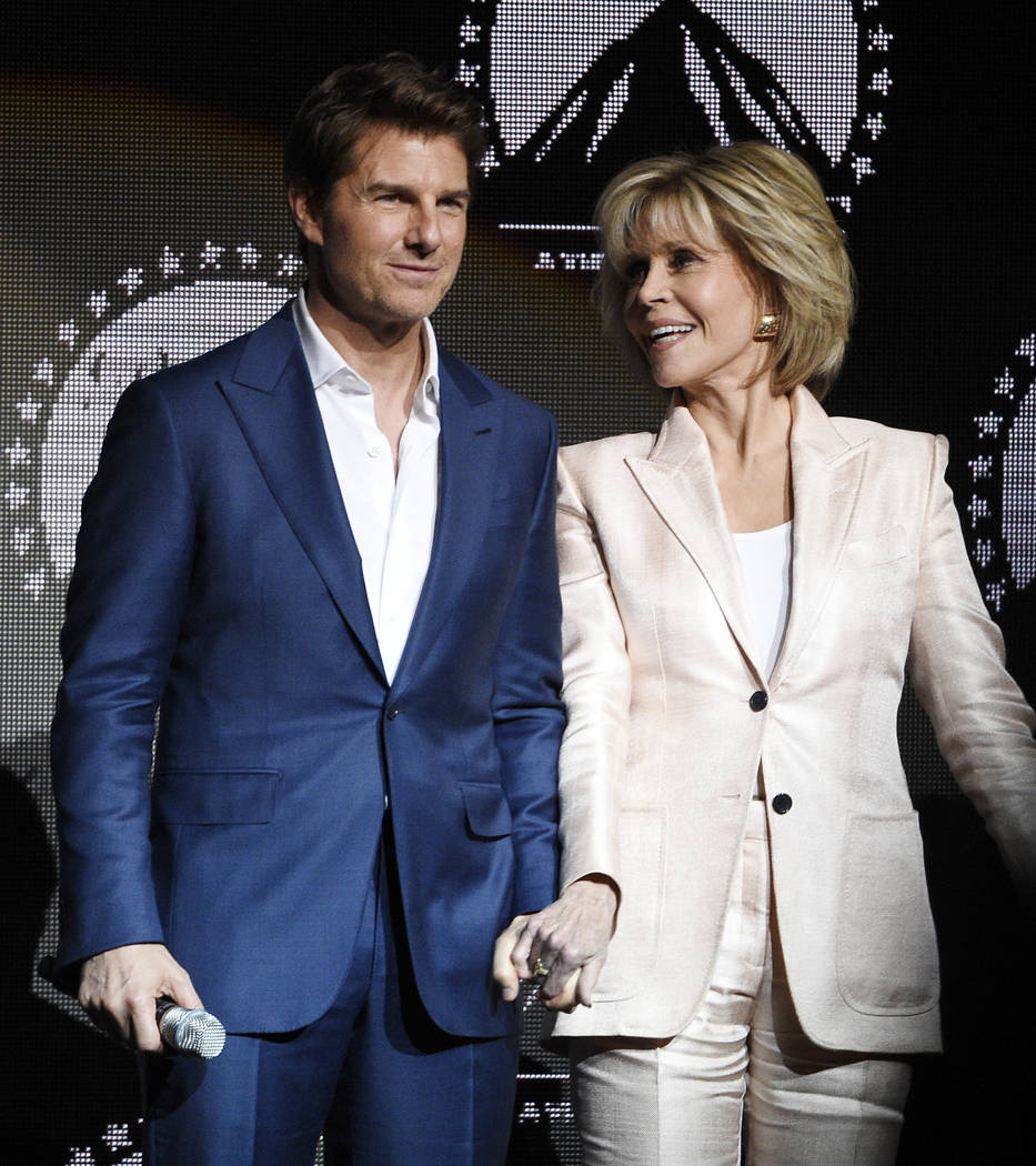 """Tom Cruise, left, star of the upcoming film """"Mission: Impossible - Fallout,"""" joins hands onstage with Jane Fonda, a cast member in the upcoming film """"Book Club,"""" at the close o ..."""