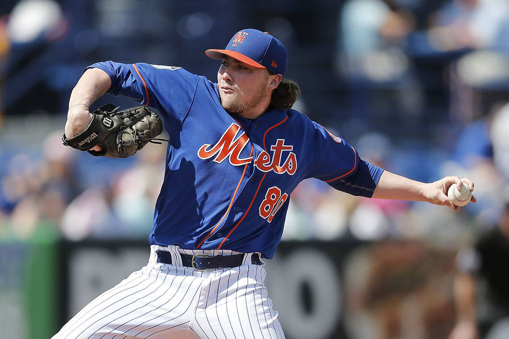 New York Mets starting pitcher P.J. Conlon (80) works against the Houston Astros in the first inning of a spring training baseball game Monday, Feb. 27, 2017, in Port St. Lucie, Fla. (AP Photo/Joh ...