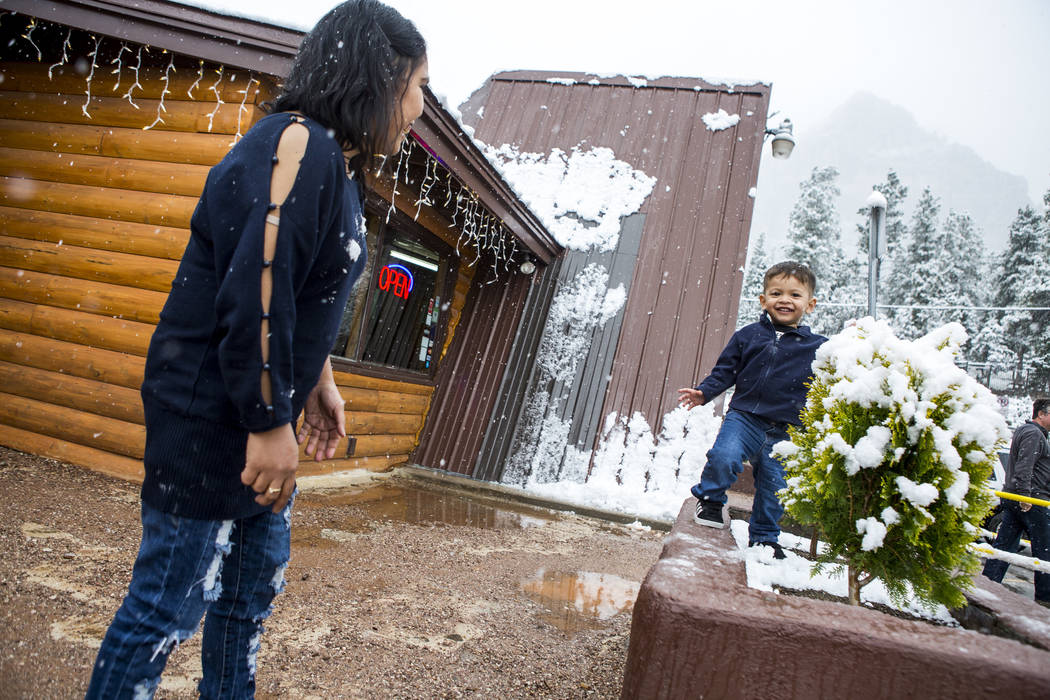 Nofi Simanungkalit and her son, David, 2, enjoy snow outside of the Mt. Charleston Lodge on Tuesday, May 1, 2018. Patrick Connolly Las Vegas Review-Journal @PConnPie