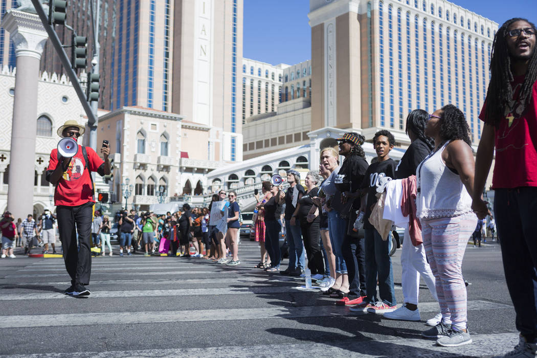 Protesters block the Las Vegas Strip in front of The Venetian to protest the officer-involved death of Tashii Brown on May 28, 2017. (Elizabeth Brumley/Las Vegas Review-Journal)