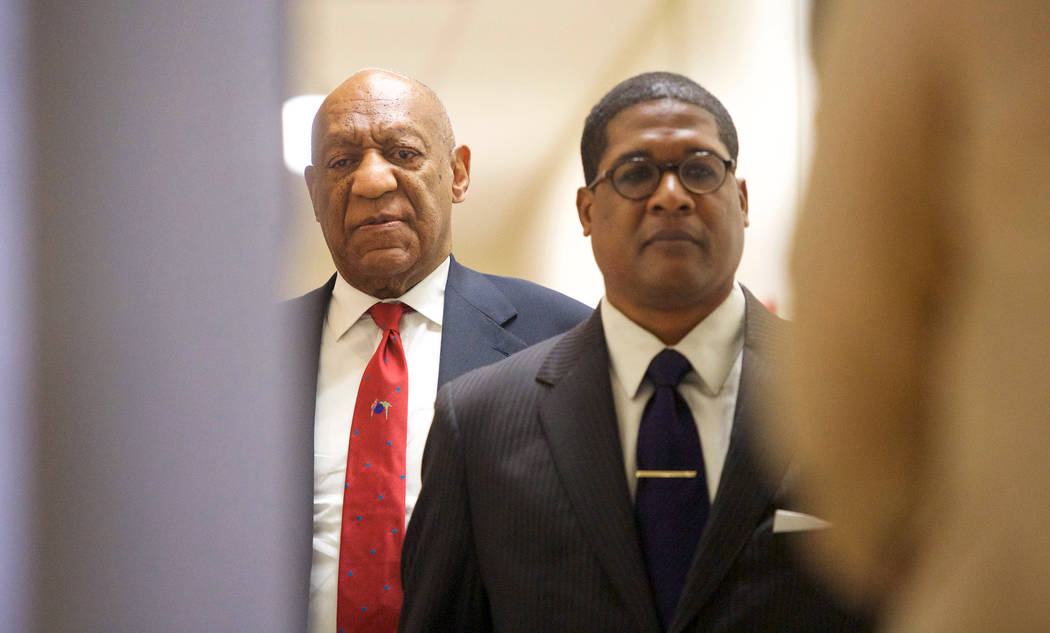 Actor and comedian Bill Cosby, left, reacts after being notified a verdict was in in his sexual assault retrial, Thursday, April, 26, 2018, at the Montgomery County Courthouse in Norristown, Pa. A ...