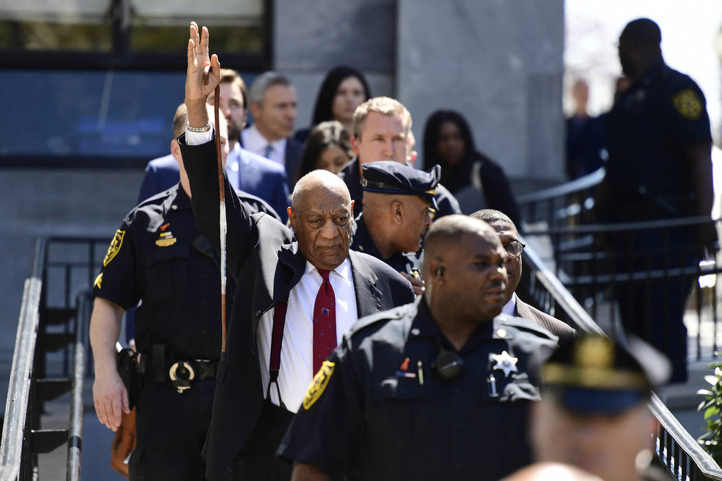 Bill Cosby gestures as he leaves his sexual assault trial at the Montgomery County Courthouse, Thursday, April 26, 2018, in Norristown, Pa. Cosby was convicted Thursday of drugging and molesting ...