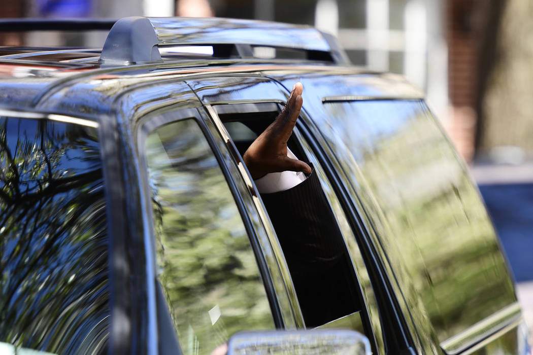 Andrew Wyatt spokesperson for actor and comedian Bill Cosby, waves as he leaves with Bill Cosby after Cosby's sexual assault trial at the Montgomery County Courthouse, Thursday, April 26, 2018, in ...