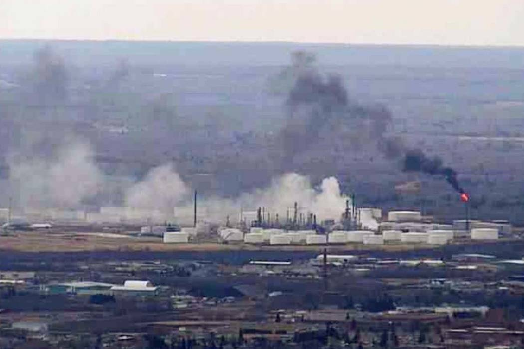 This image from video shows smoke rising from the Husky Energy oil refinery after an explosion Thursday morning, April 26, 2018 in Superior, Wisconsin. (WDIO-TV via AP)