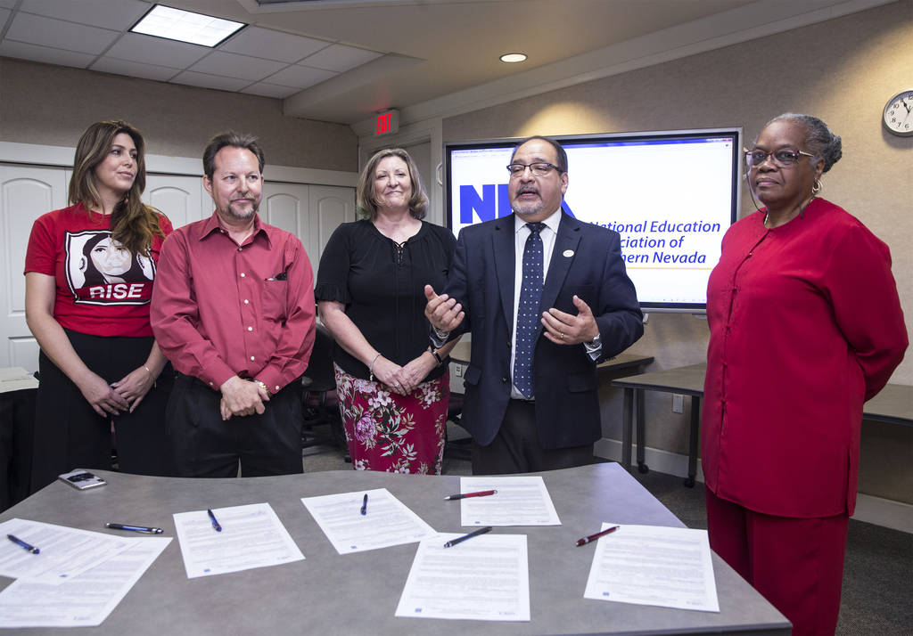 Mercedes Krause, left, Chet Miller, Carmen Andrews, Ruben Murillo and Patricia Stevens officially announce a new teachers union for Clark County educators called the National Education Association ...