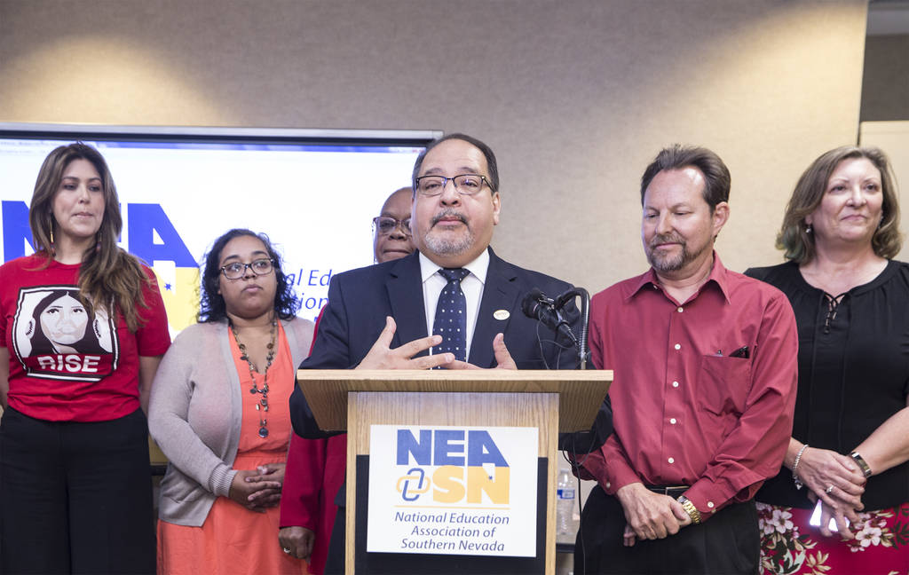 Ruben Murillo, middle, president of the Nevada State Education Association, addresses the media during a press conference to formally announce a new teachers union on Thursday, April 26, 2018, at ...