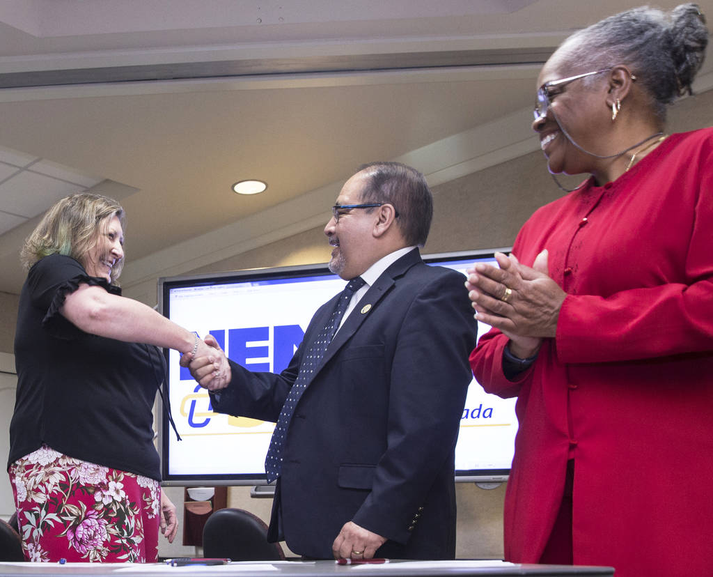 Carmen Andrews, left, shakes hands with Ruben Murillo with Patricia Stevens after signing paperwork officially creating a new teachers union for Clark County educators on Thursday, April 26, 2018, ...