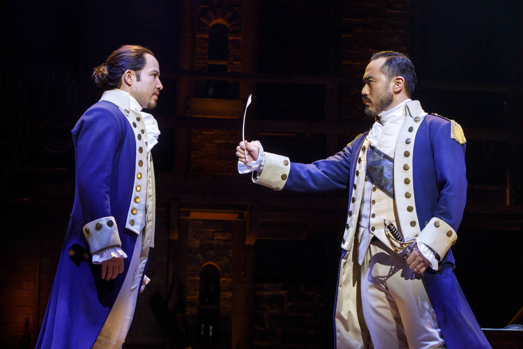 "Joseph Morales as Alexander Hamilton, left, and Marcus Choi as George Washington in the national touring production of ""Hamilton,"" playing The Smith Center May 29-June 24."