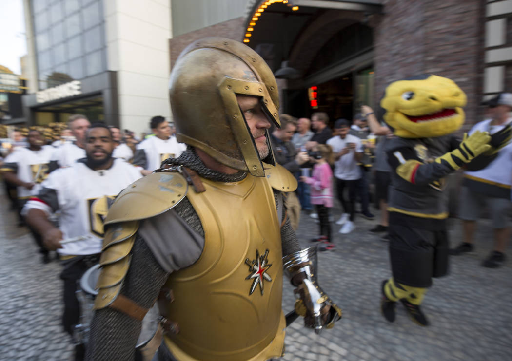 The Vegas Golden Knight and Chance the Golden Gila Monster participate in the March to the Fortress ahead of Game 1 of an NHL hockey first-round playoff series between the Golden Knights and the L ...