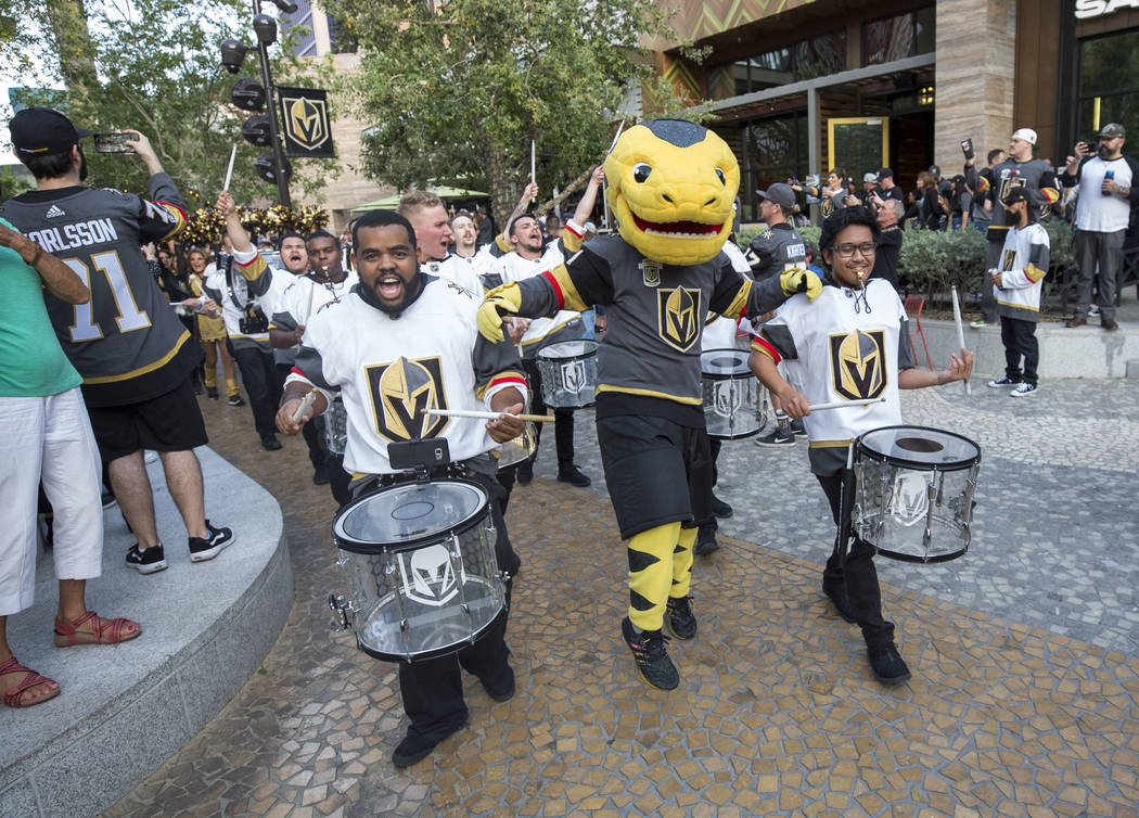 The Vegas Golden Knights mascot Chance the Golden Gila Monster and the Knight Line participates in the March to the Fortress ahead of Game 1 of an NHL hockey first-round playoff series between the ...