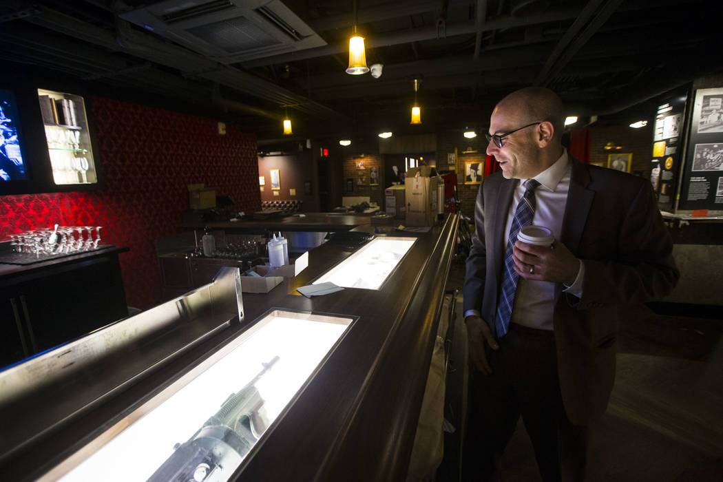 Jonathan Ullman, president and chief executive officer of The Mob Museum, looks over Prohibition-era artifacts in the speakeasy at The Underground at The Mob Museum in downtown Las Vegas on Saturd ...