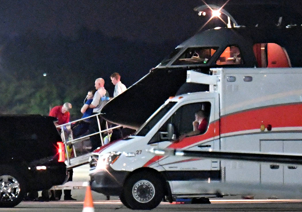 A person believed to be Otto Warmbier is transferred from a medical transport airplane to an awaiting ambulance at Lunken Airport in Cincinnati, Ohio, on June 13, 2017. (Bryan Woolston/AP) T