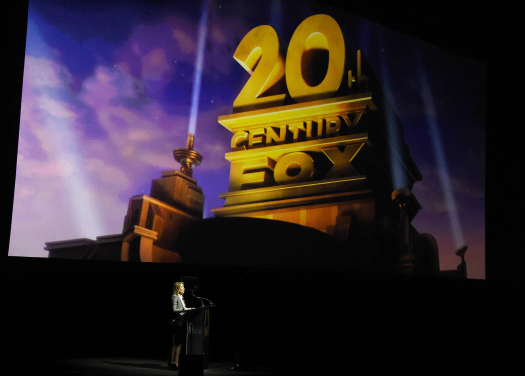 Stacey Snider, chairman and CEO of 20th Century Fox Film, addresses the audience underneath the company logo during the 20th Century Fox presentation at CinemaCon 2018, the official convention of ...