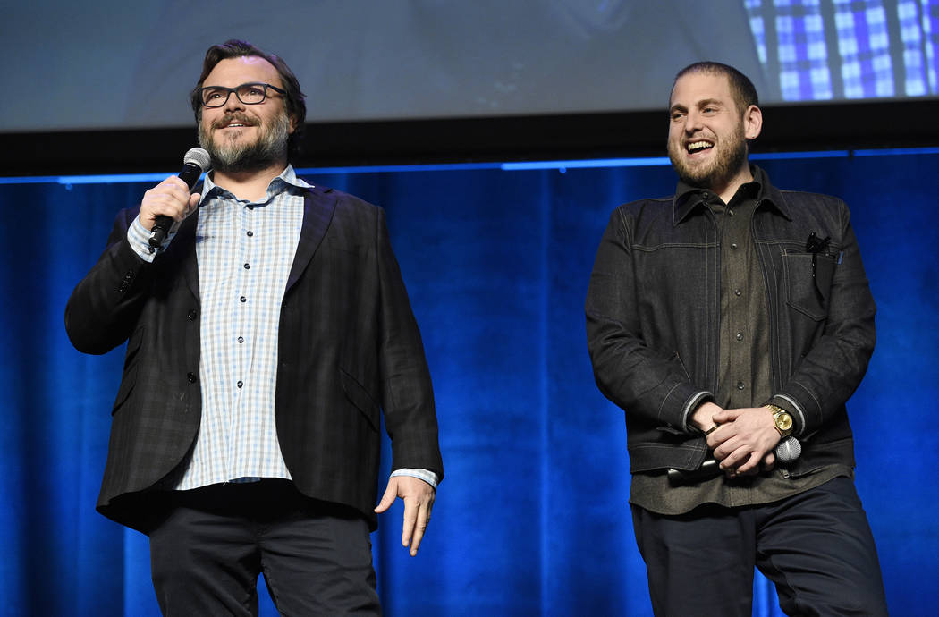 "Jack Black, left, and Jonah Hill, cast members in ""Don't Worry, He Won't Get Far on Foot,"" share the stage during the Amazon Studios presentation at CinemaCon. (Photo by Chris Pizzello/I ..."