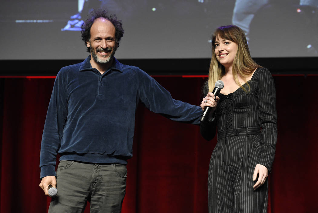 "Luca Guadagnino, director of ""Suspiria,"" and actress Dakota Johnson discuss the film during the Amazon Studios presentation at CinemaCon on Thursday at Caesars Palace. (Photo by Chris Pi ..."