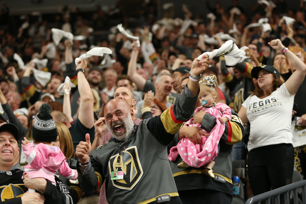 Vegas Golden Knights fans celebrates a score during the first period in Game 1 of an NHL hockey second-round playoff series at T-Mobile Arena in Las Vegas in Las Vegas, Thursday, April 26, 2018. E ...