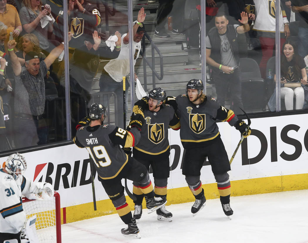 Golden Knights center Jonathan Marchessault, center, celebrates his goal against the San Jose Sharks with right wing Reilly Smith (19) and center William Karlsson (71) during the first period of G ...