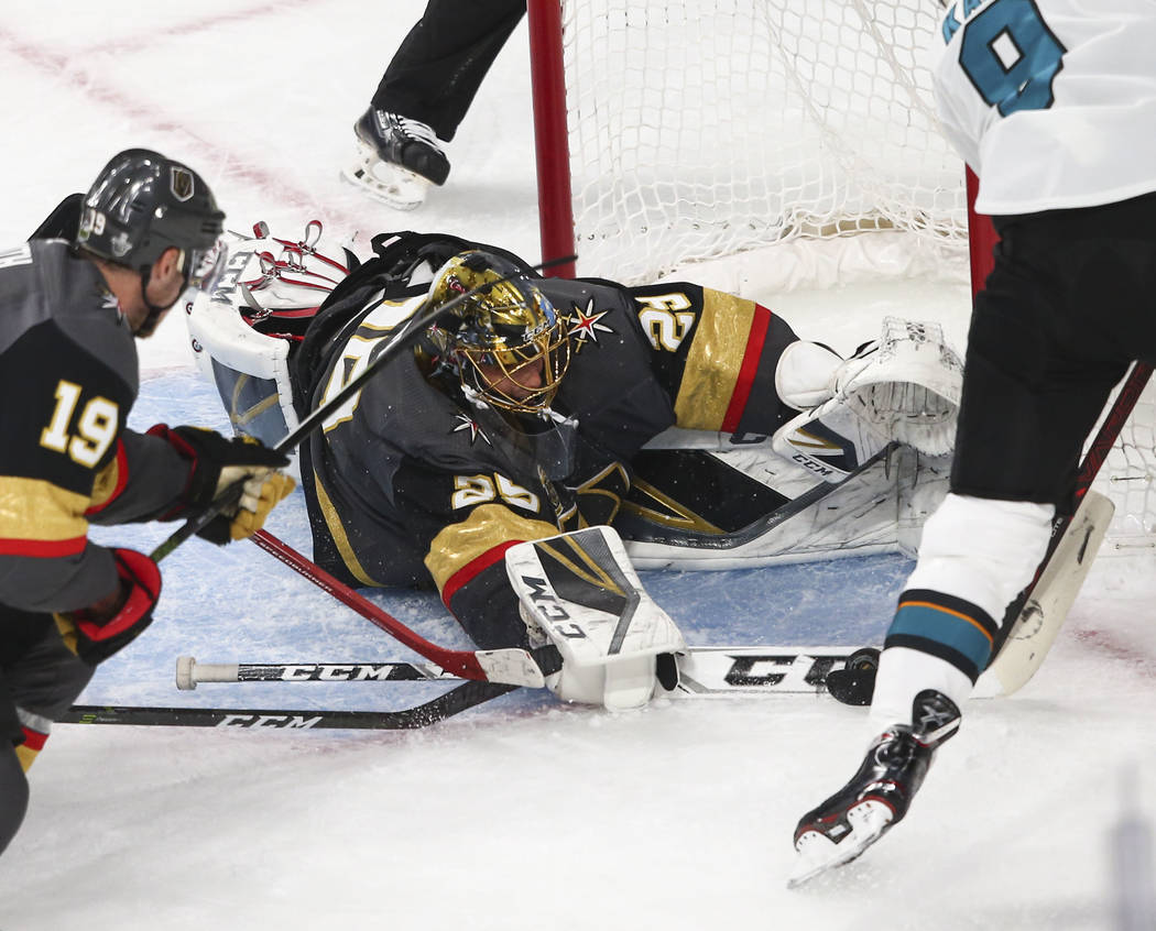 Golden Knights goaltender Marc-Andre Fleury (29) blocks a shot from San Jose Sharks left wing Evander Kane (9) during the first period of Game 1 of an NHL hockey second-round playoff series at T-M ...