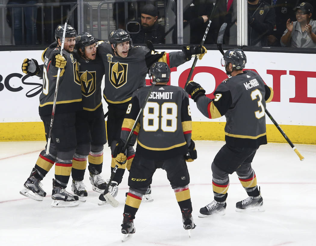 Golden Knights center Cody Eakin, second from left, celebrates his goal against the San Jose Sharks with teammates during the first period of Game 1 of an NHL hockey second-round playoff series at ...