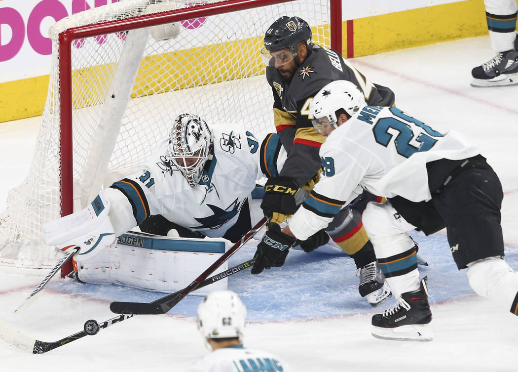 Golden Knights left wing Pierre-Edouard Bellemare (41) battles for the puck against San Jose Sharks goaltender Martin Jones (31) and right wing Timo Meier (28) during the first period of Game 1 of ...
