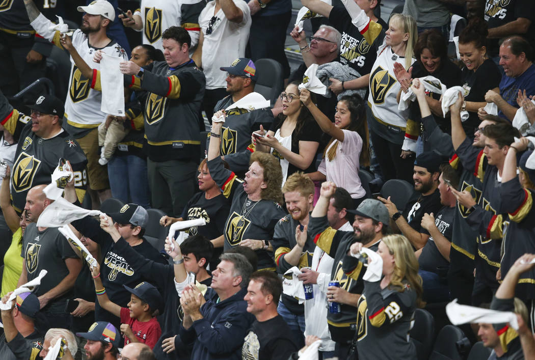 Golden Knights fans celebrate a goal by center Cody Eakin, not pictured, during the first period of Game 1 of an NHL hockey second-round playoff series against the San Jose Sharks at T-Mobile Aren ...