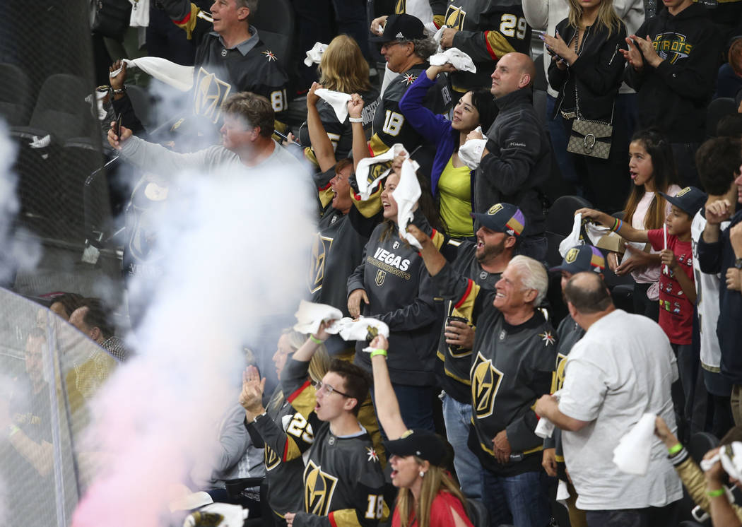 Golden Knights fans celebrate a goal by Golden Knights defenseman Shea Theodore, not pictured, during the second period of Game 1 of an NHL hockey second-round playoff series against the San Jose ...