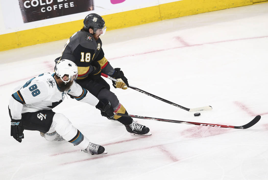 Golden Knights left wing James Neal (18) controls the puck as San Jose Sharks defenseman Brent Burns (88) defends during the second period of Game 1 of an NHL hockey second-round playoff series at ...