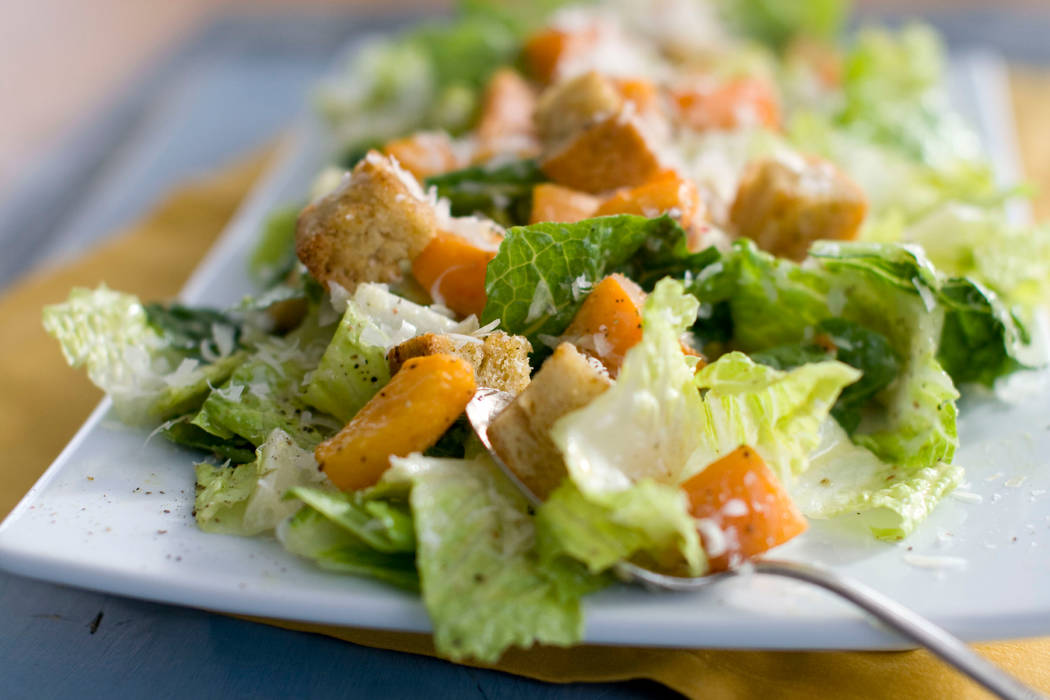 A plate of butternut Caesar salad with Romaine lettuce and roasted cubes of butternut squash. (AP Photo/Matthew Mead, File)
