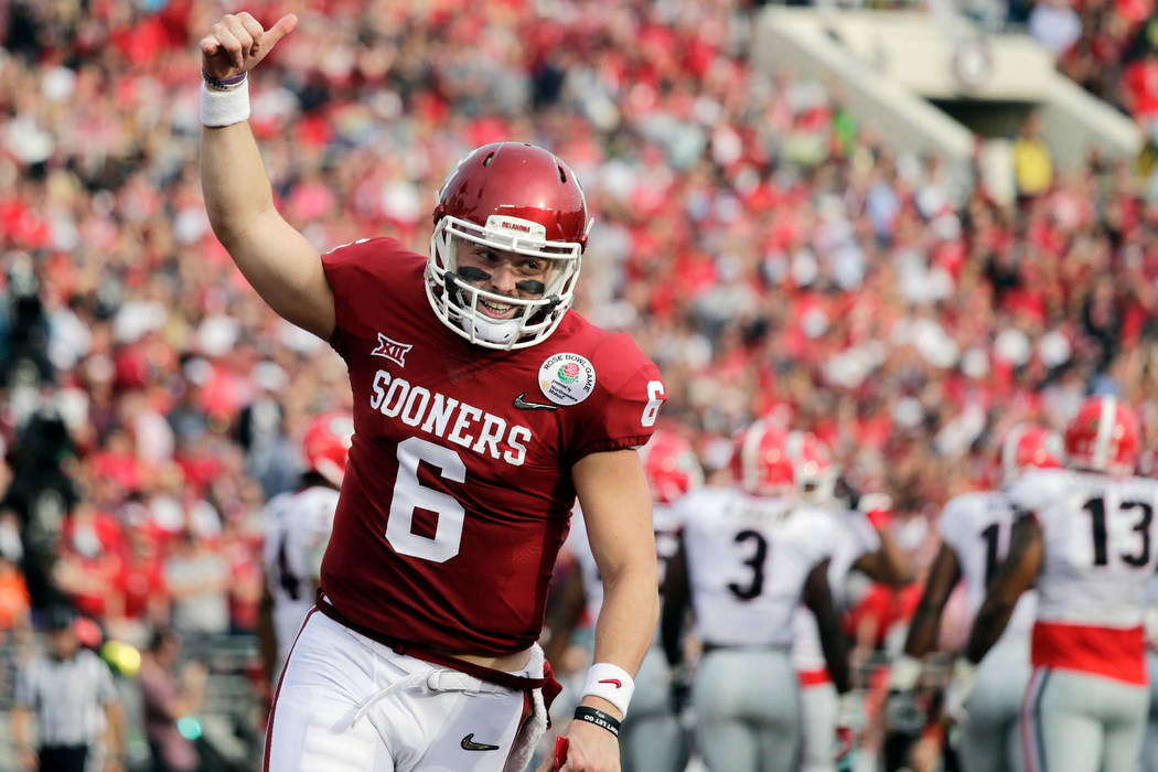 In this Jan. 1, 2018, file photo, Oklahoma quarterback Baker Mayfield celebrates after running back Rodney Anderson scored a touchdown against Georgia during the first half of the Rose Bowl NCAA c ...