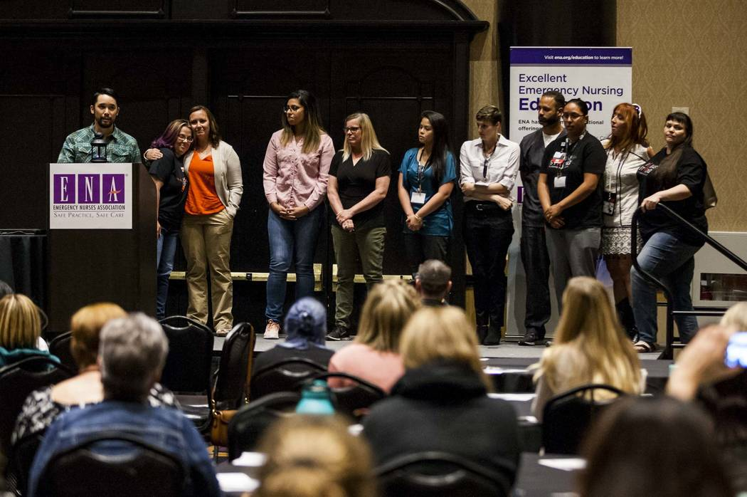 Dr. Kevin Menes calls up his team from Sunrise Hospital while talking about the night of Oct. 1 at the Emergency Nurses Association regional symposium at Planet Hollywood on Thursday, April 26, 20 ...
