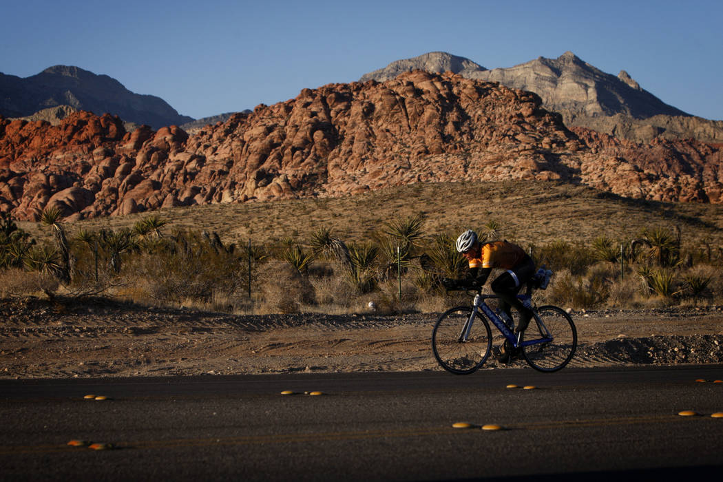 A cyclist rides along State Route 159 in front of Red Rock Canyon National Conservation Area outside Las Vegas in 2011. (Las Vegas Review-Journal)
