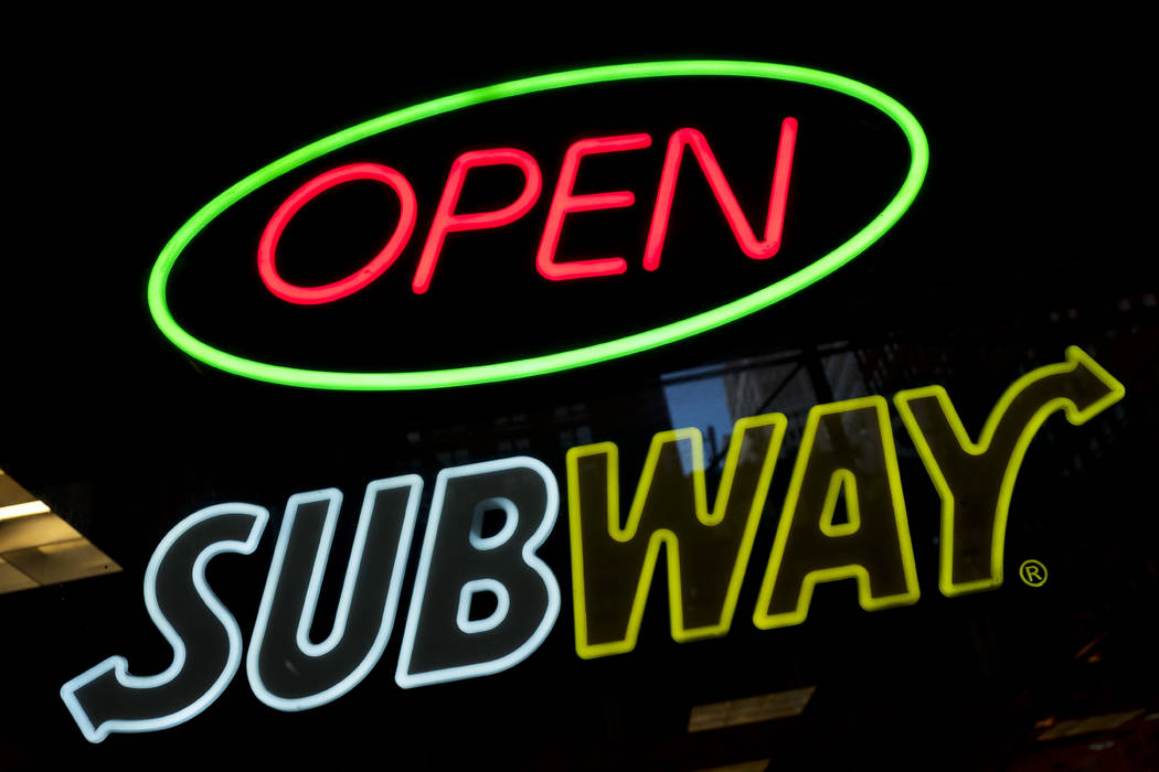 In this Oct. 24, 2016, file photo, a Subway fast food restaurant's sign is shown in New York. (AP Photo/Mark Lennihan, File)