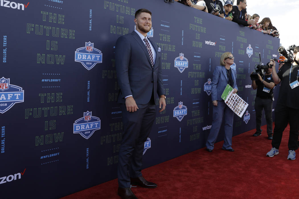 UCLA's Kolton Miller poses for photos on the red carpet before the first round of the NFL football draft, Thursday, April 26, 2018, in Arlington, Texas. (AP Photo/Eric Gay)