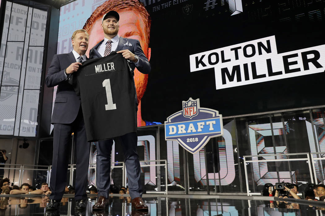 Commissioner Roger Goodell, left, presents UCLA's Kolton Miller with his Oakland Raiders jersey during the first round of the NFL football draft, Thursday, April 26, 2018, in Arlington, Texas. (AP ...