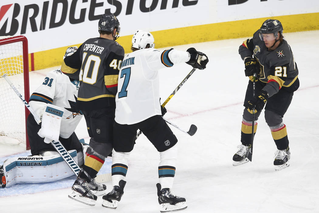 Golden Knights center Cody Eakin (21) shoots to score a goal past San Jose Sharks goaltender Martin Jones (31) during the first period of Game 1 of an NHL hockey second-round playoff series at T-M ...