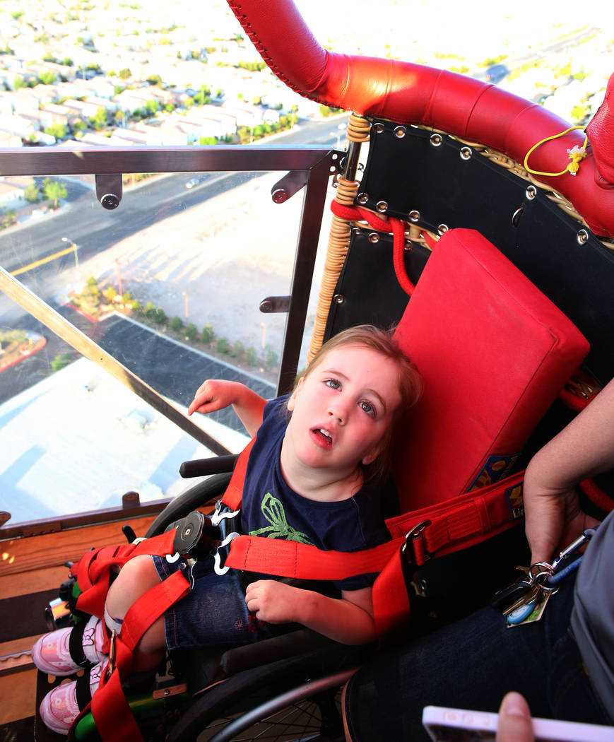 Lexi Winslow, 4, enjoys a hot air balloon ride on Friday, April 27, 2018, in Las Vegas. Local American Family Insurance agents are holding a fundraiser on Saturday for Lexi who has cerebral palsy. ...