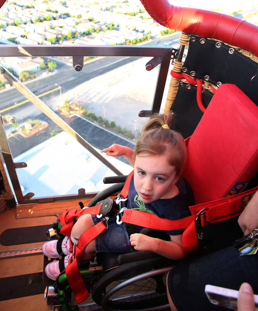 Lexi Winslow, 4, enjoys a hot air balloon ride on Friday, April 27, 2018, in Las Vegas. Local American Family Insurance agents are holding a fundraiser Saturday for Lexi who has cerebral palsy. B ...