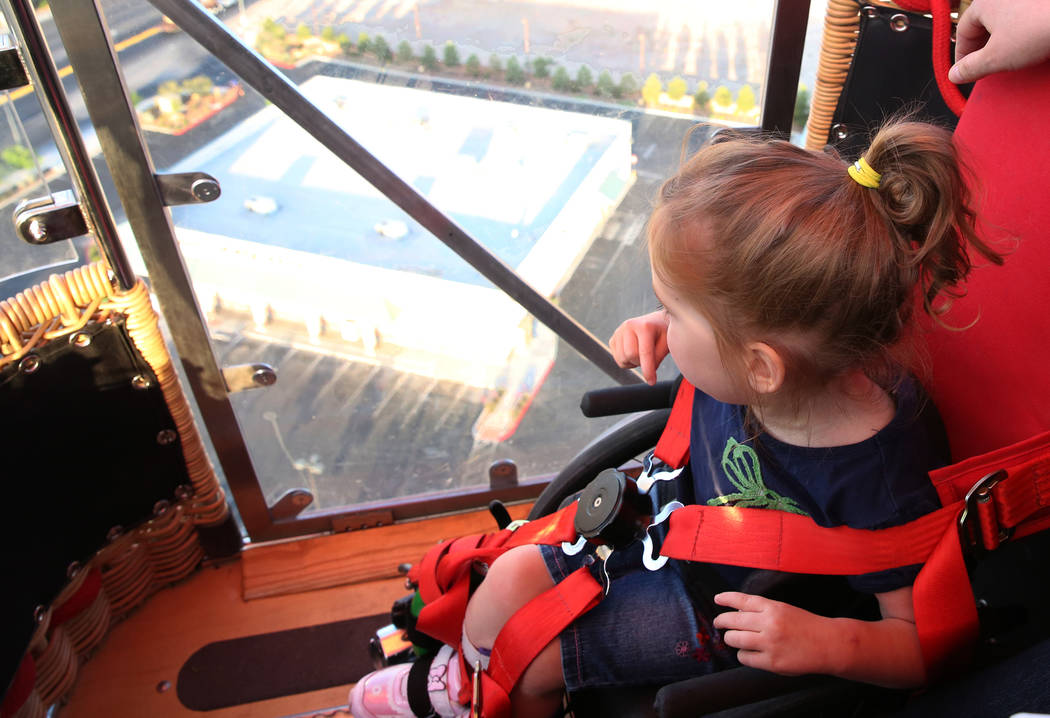 Lexi Winslow, 4, enjoys a hot air balloon ride on Friday, April 27, 2018, in Las Vegas. Local American Family Insurance agents are holding a fundraiser Saturday for Lexi who has cerebral palsy. Bi ...
