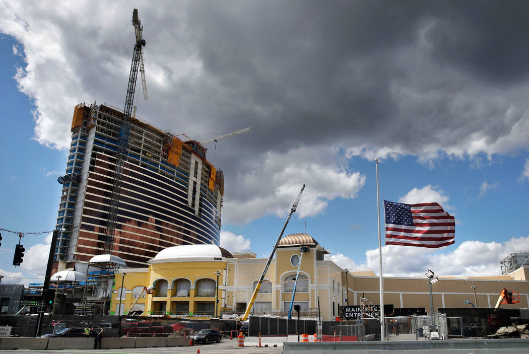 Clouds pass over the Wynn Resorts casino construction site in Everett, Mass., Thursday, April 26, 2018. Massachusetts gambling regulators consider Wynn Resorts' request to remove the name of compa ...
