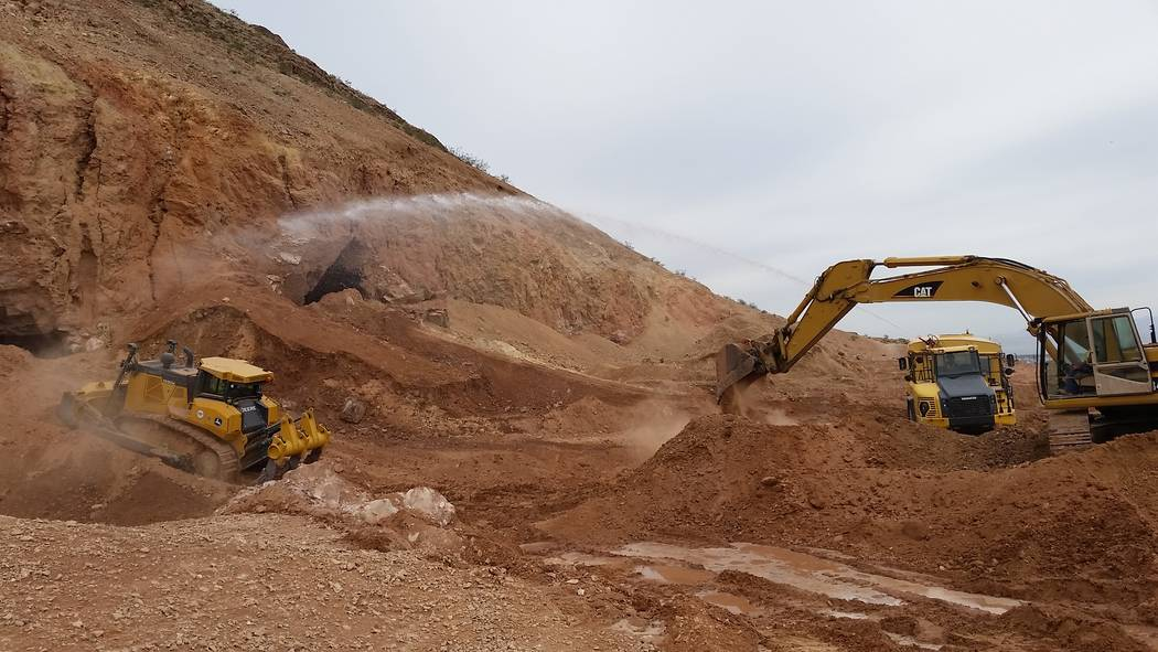 A construction crew closes abandoned mine openings in the hills west of Fort Apache and Warm Springs roads on April 4. Nevada Division of Minerals