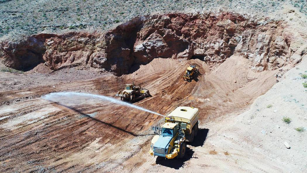 A construction crew fills in abandoned mine openings in the hills west of Fort Apache and Warm Springs roads on April 17. Nevada Division of Minerals