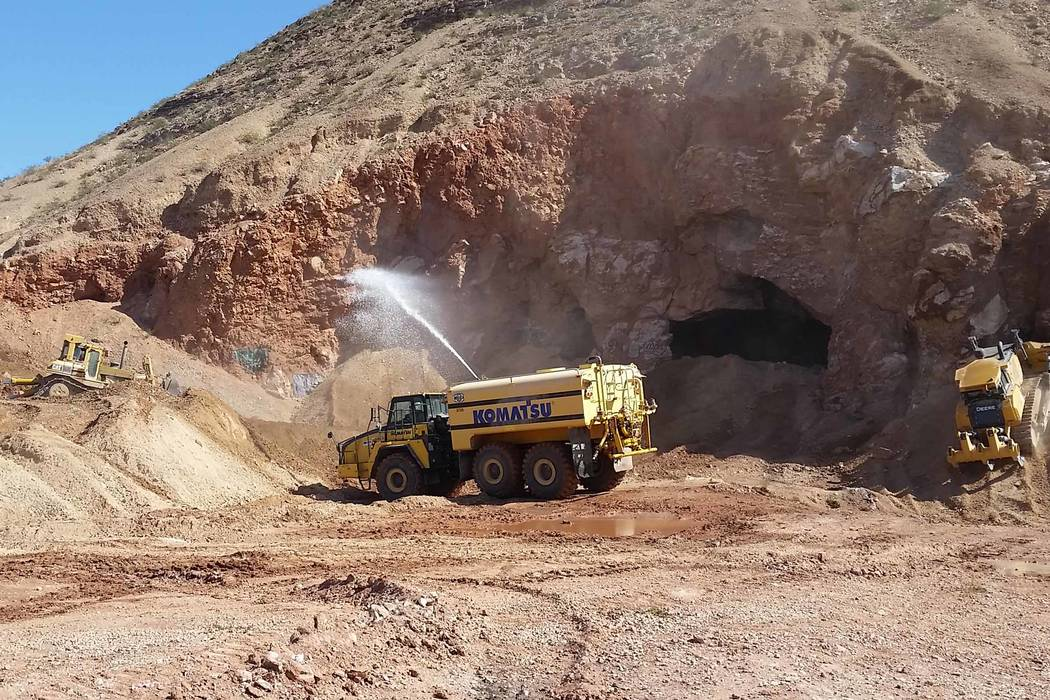 A construction crew fills in abandoned mine openings in the hills west of Fort Apache and Warm Springs roads on April 9. Nevada Division of Minerals