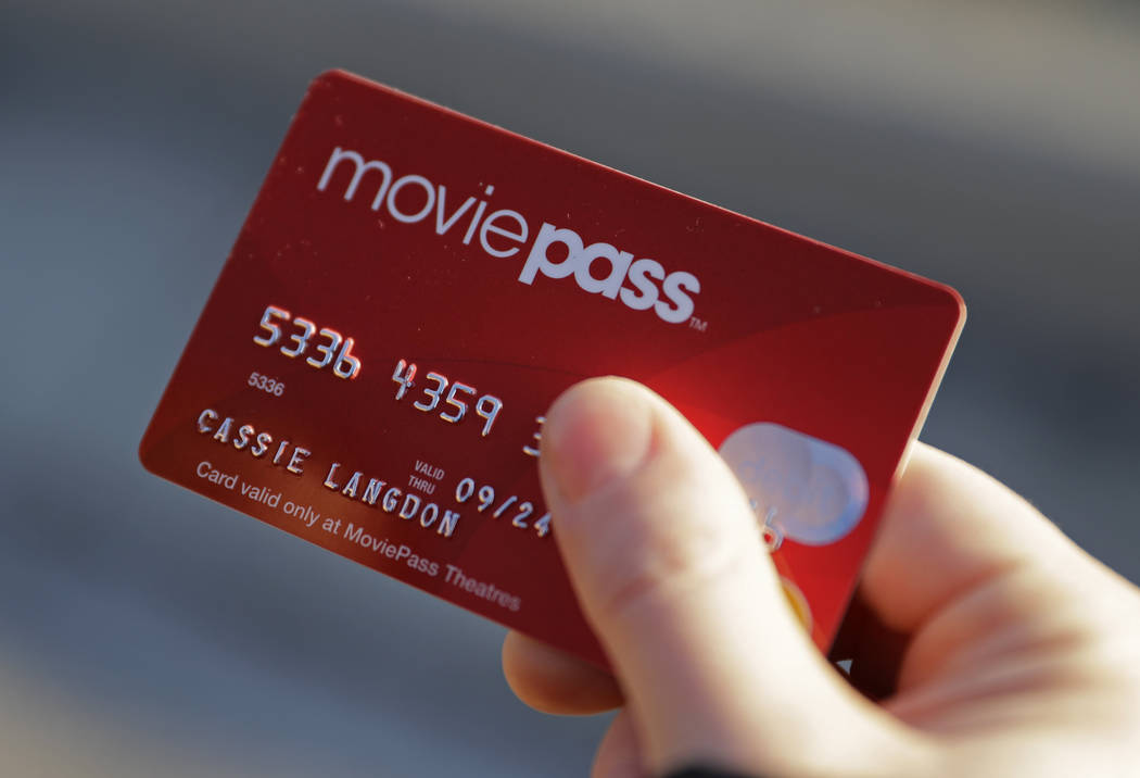 Cassie Langdon holds her MoviePass card outside AMC Indianapolis 17 theatre in Indianapolis, Tuesday, Jan. 30, 2018. New rules allow new subscribers four movies per month. (Darron Cummings/AP)