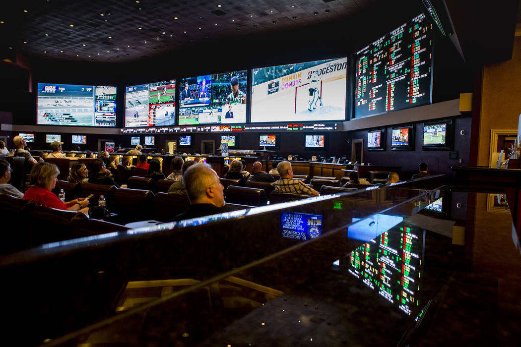 Sports betters watch the Golden Knights play the San Jose Sharks during the second round of the NHL playoffs at the Green Valley Ranch sports book in Henderson on Thursday, April 26, 2018. Patric ...