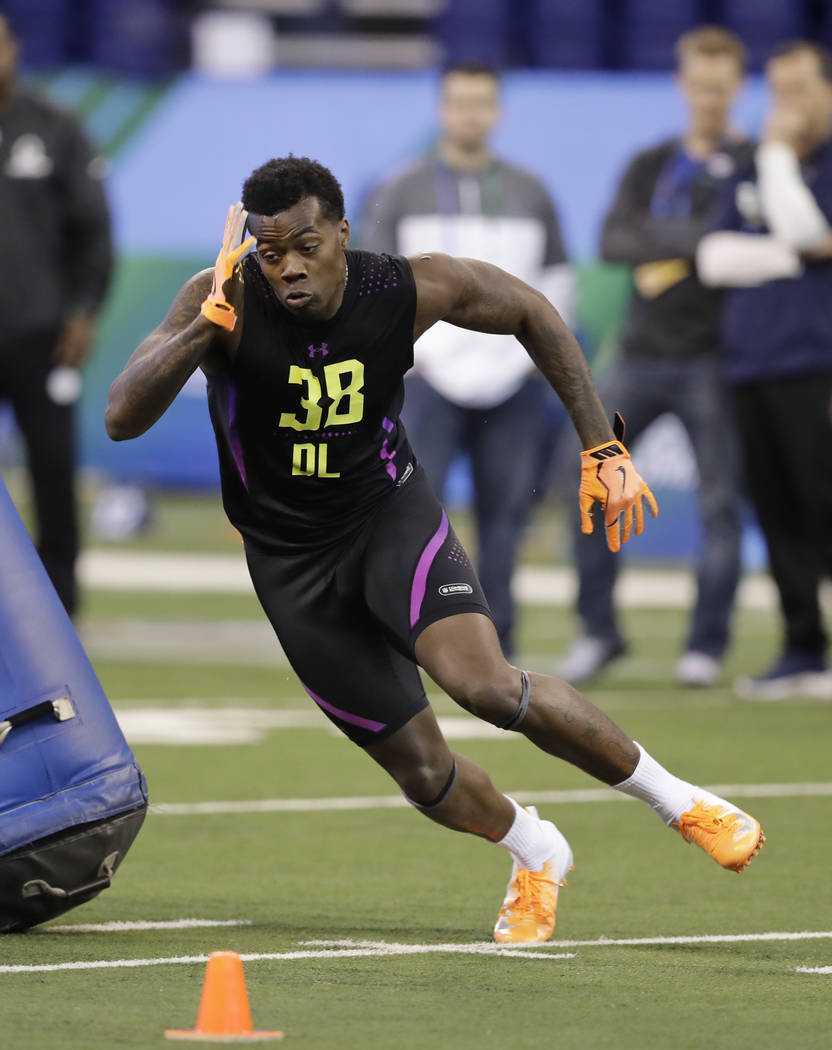 LSU defensive lineman Arden Key runs a drill during the NFL football scouting combine, Sunday, March 4, 2018, in Indianapolis. (AP Photo/Darron Cummings)