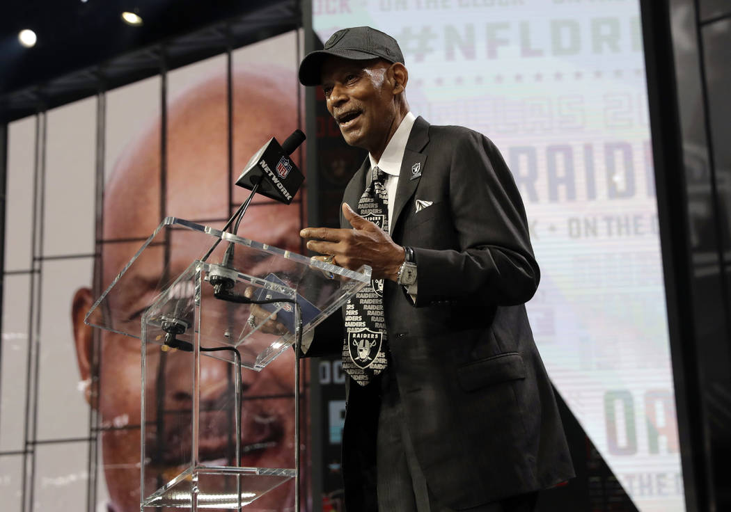 """Former player William """"Willie"""" Brown announces Sam Houston State's P.J. Hall as the Los Angeles Raiders' selection during the second round of the NFL football draft Friday, April 27, 201 ..."""