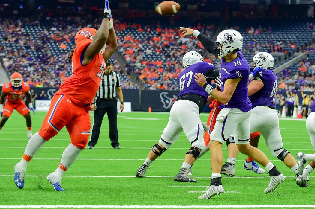 Sam Houston State Bearkats defensive lineman P.J. Hall (92) gets in the face of Stephen F. Austin Lumberjacks quarterback Jake Blumrick (10) during the Battle of the Piney Woods football game betw ...