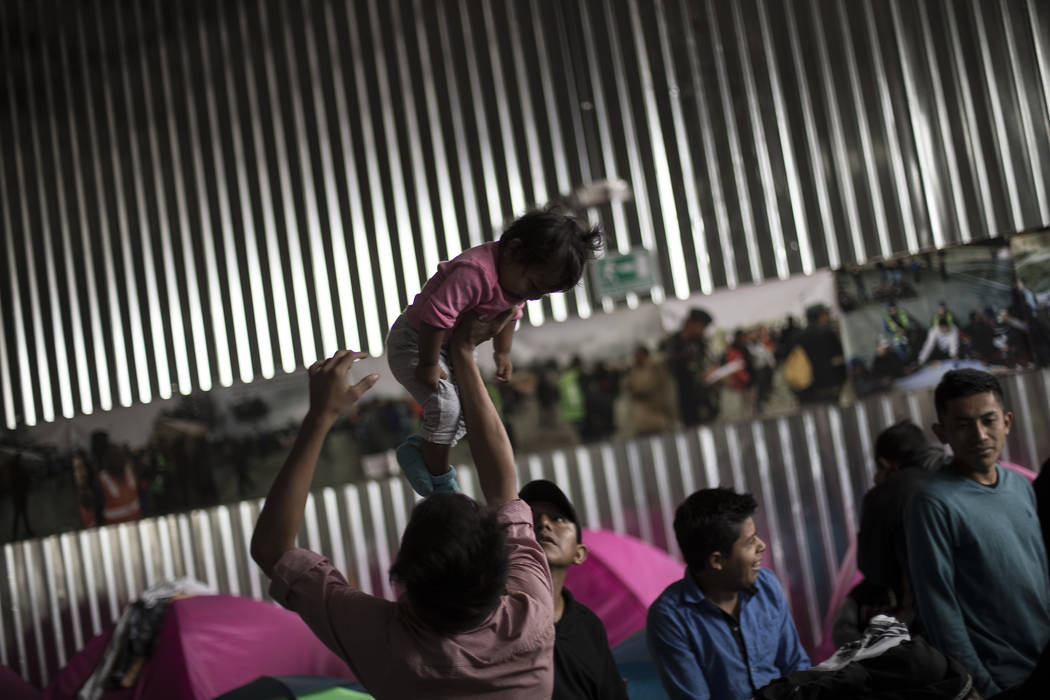 Migrants rise early in the morning and get ready, at the Juventudes 2000 Shelter, prior to meeting with immigration lawyers, in Tijuana Mexico, Friday, April 27, 2018. In the last 24 hours close t ...